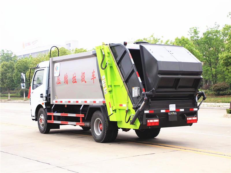 东风多利卡8方压缩式垃圾车,压缩式垃圾清运车厂家现货供应,压缩式垃圾车最新报价示例图4