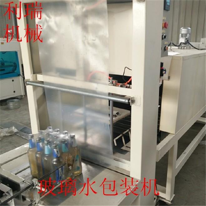 利瑞生产新型1550全自动热缩膜包装机  玻璃水包装机  保温板包装机厂家直销   啤酒易拉罐包装机图片