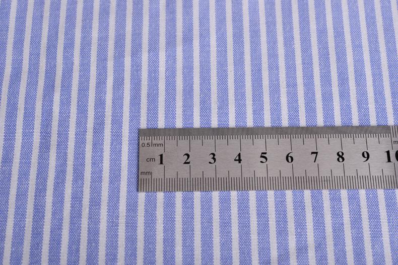 廠家直銷加厚牛津紡條子色織襯衫滌棉布料條紋布連衣裙職業裝面料示例圖9